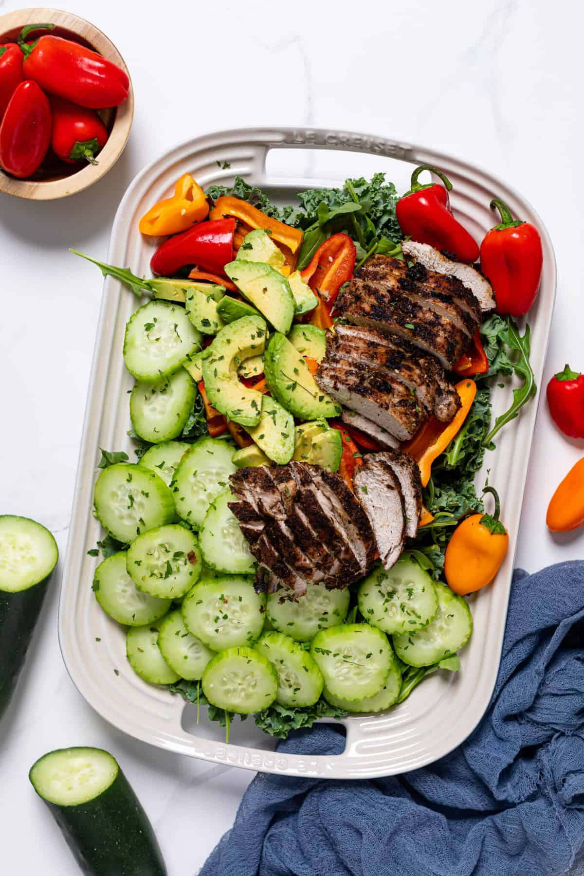 Oven Baked Jamaican Jerk Chicken Salad in a white serving platter