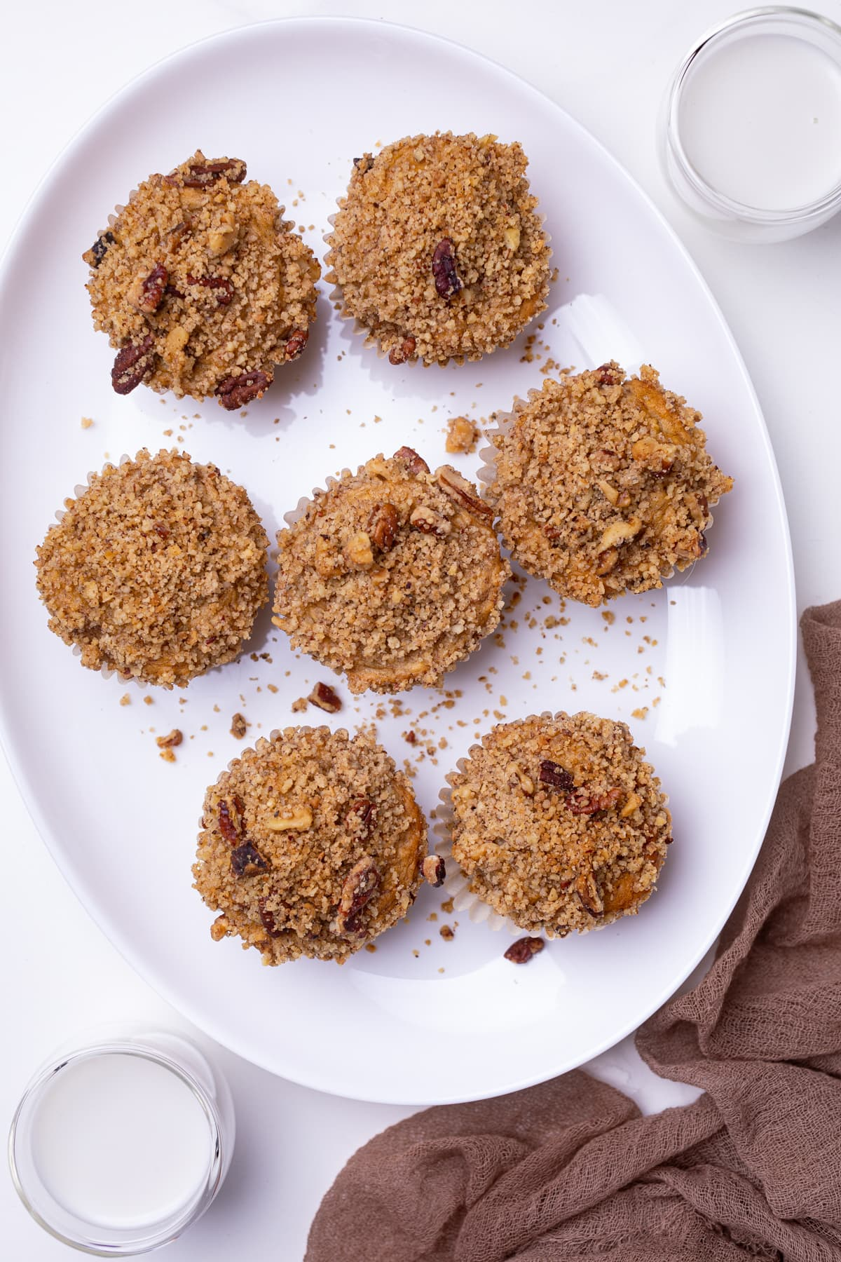 Vegan Banana Muffins with cinnamon streusel on a white plate