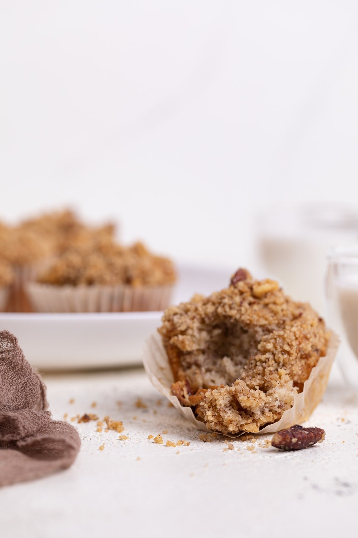 Vegan Banana Muffins with cinnamon streusel with a bite removed