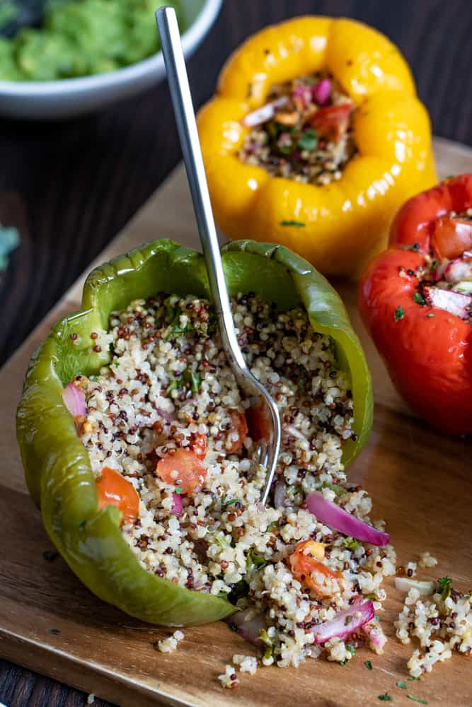 Spicy Quinoa + Veggie Stuffed Peppers