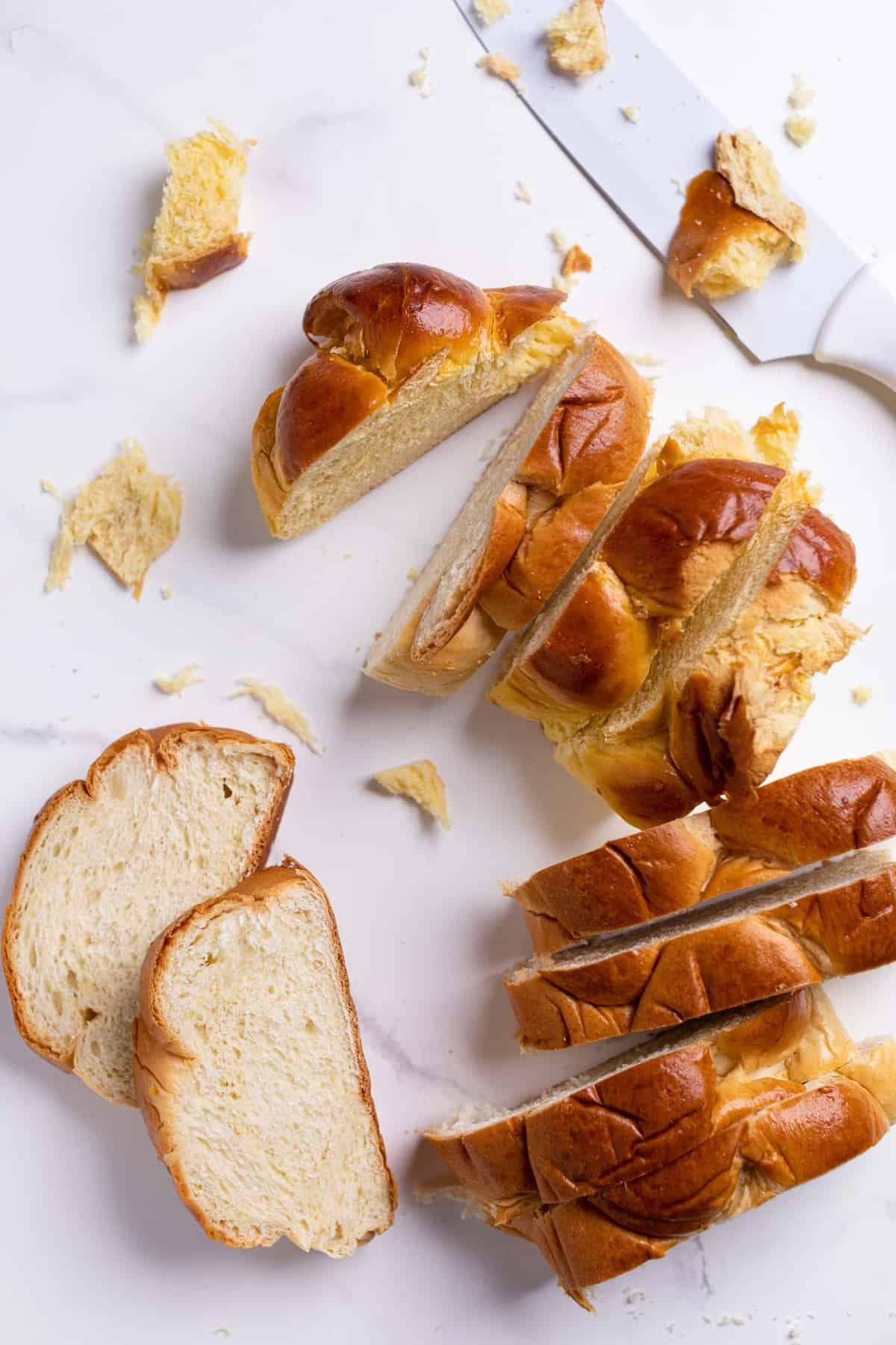 overhead of slices of challah bread on a marble counter