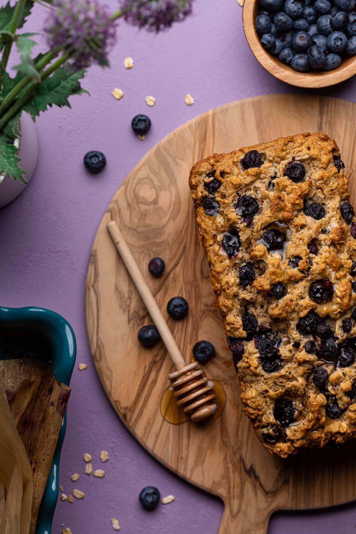Healthy Blueberry Oatmeal Breakfast Bread on a wooden cutting board
