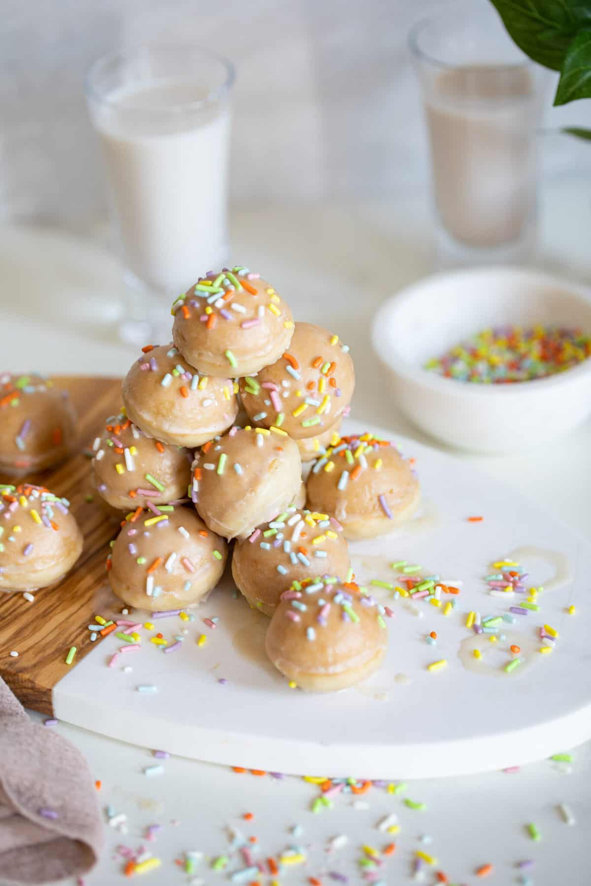 stack of vegan donut holes with rainbow sprinkles