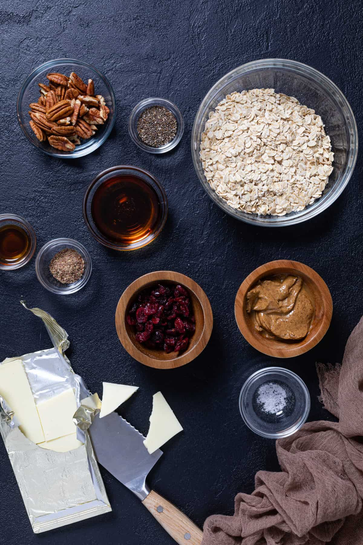 overhead of the ingredients for White Chocolate Cranberry Energy Bites in small bowls
