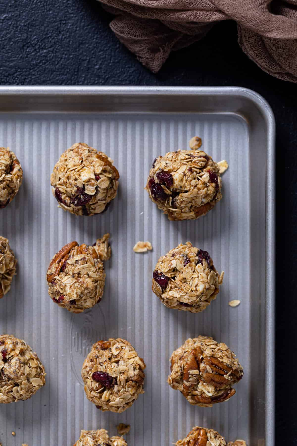 overhead of White Chocolate Cranberry Energy Bites on a baking sheet