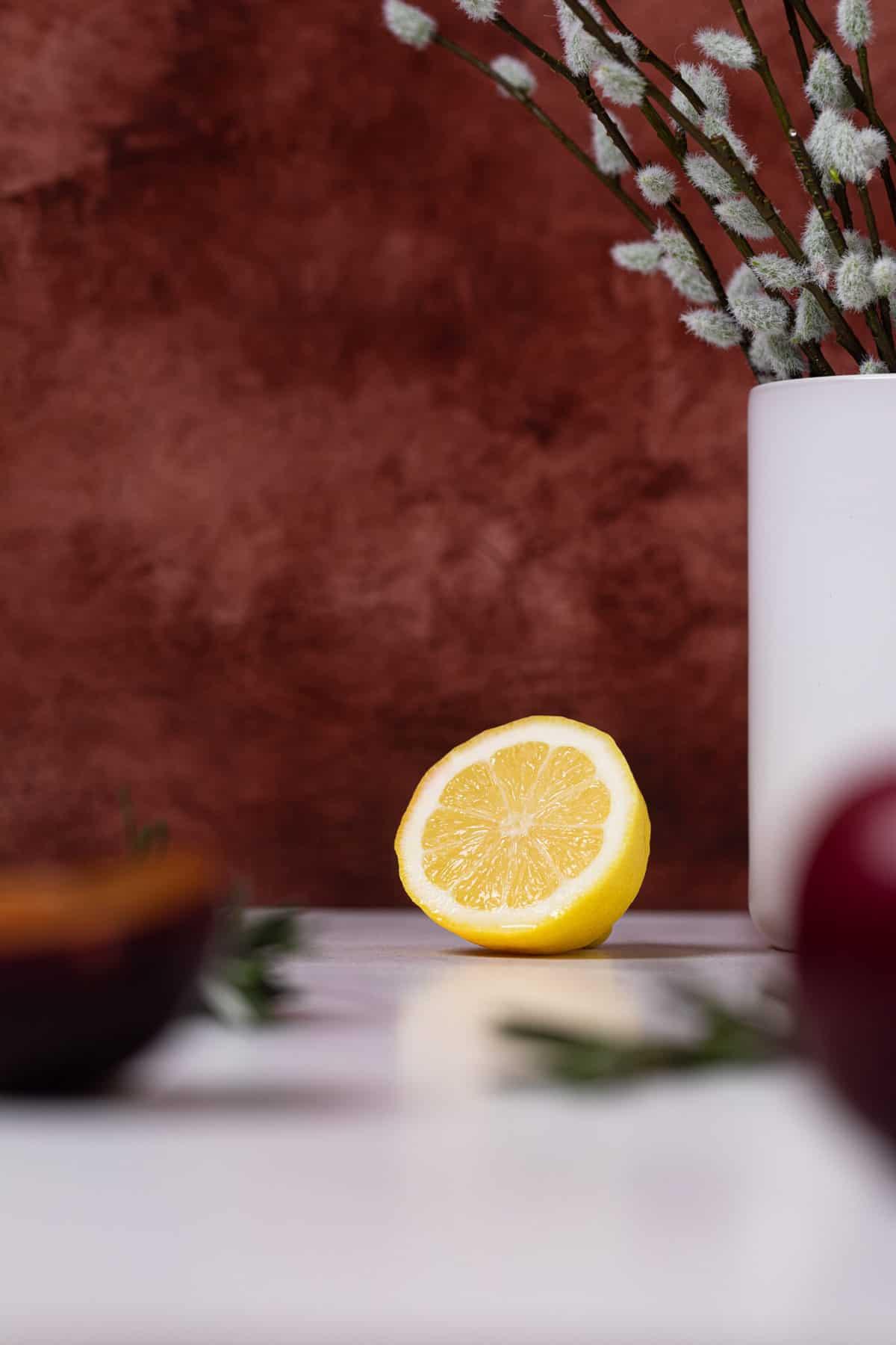 half of a lemon on a white table