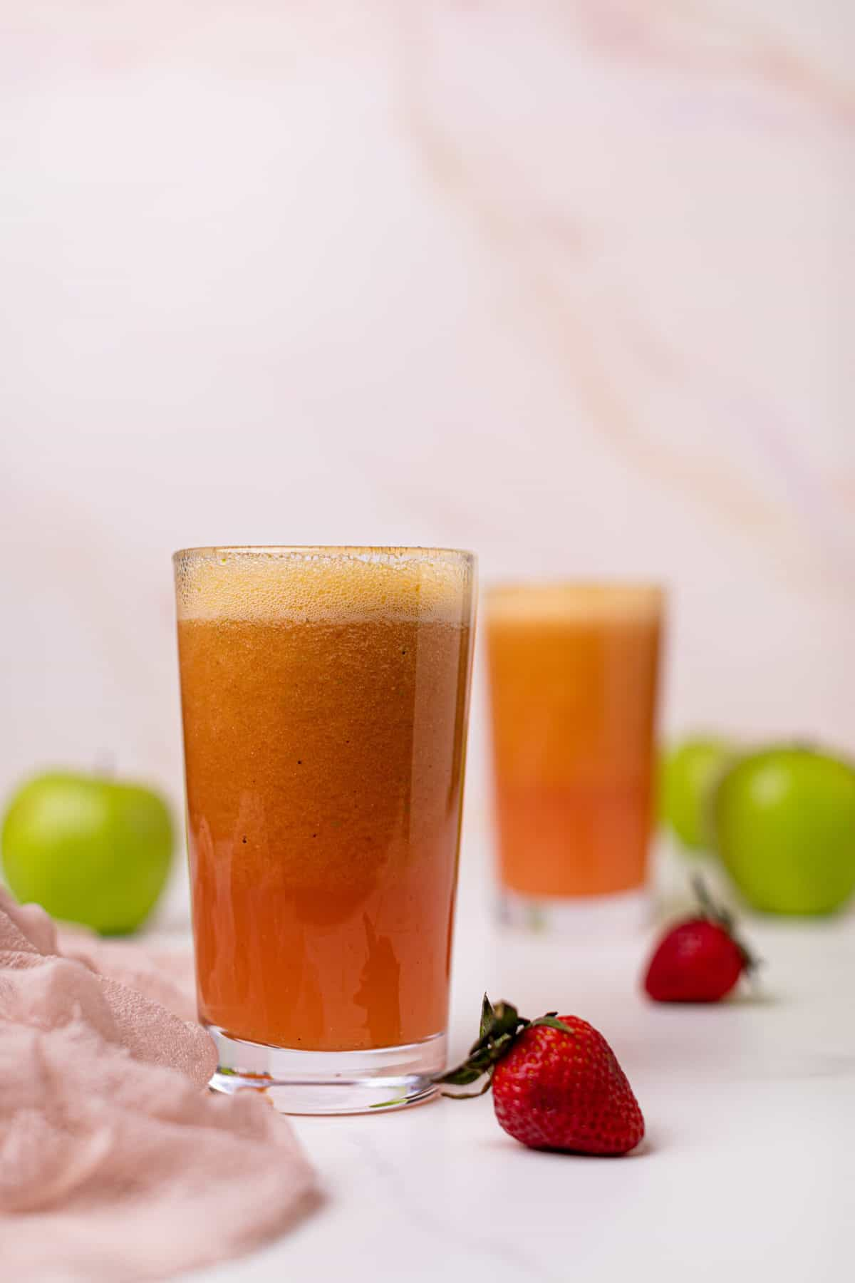 Apple Citrus Strawberry Juice in two glasses with strawberries