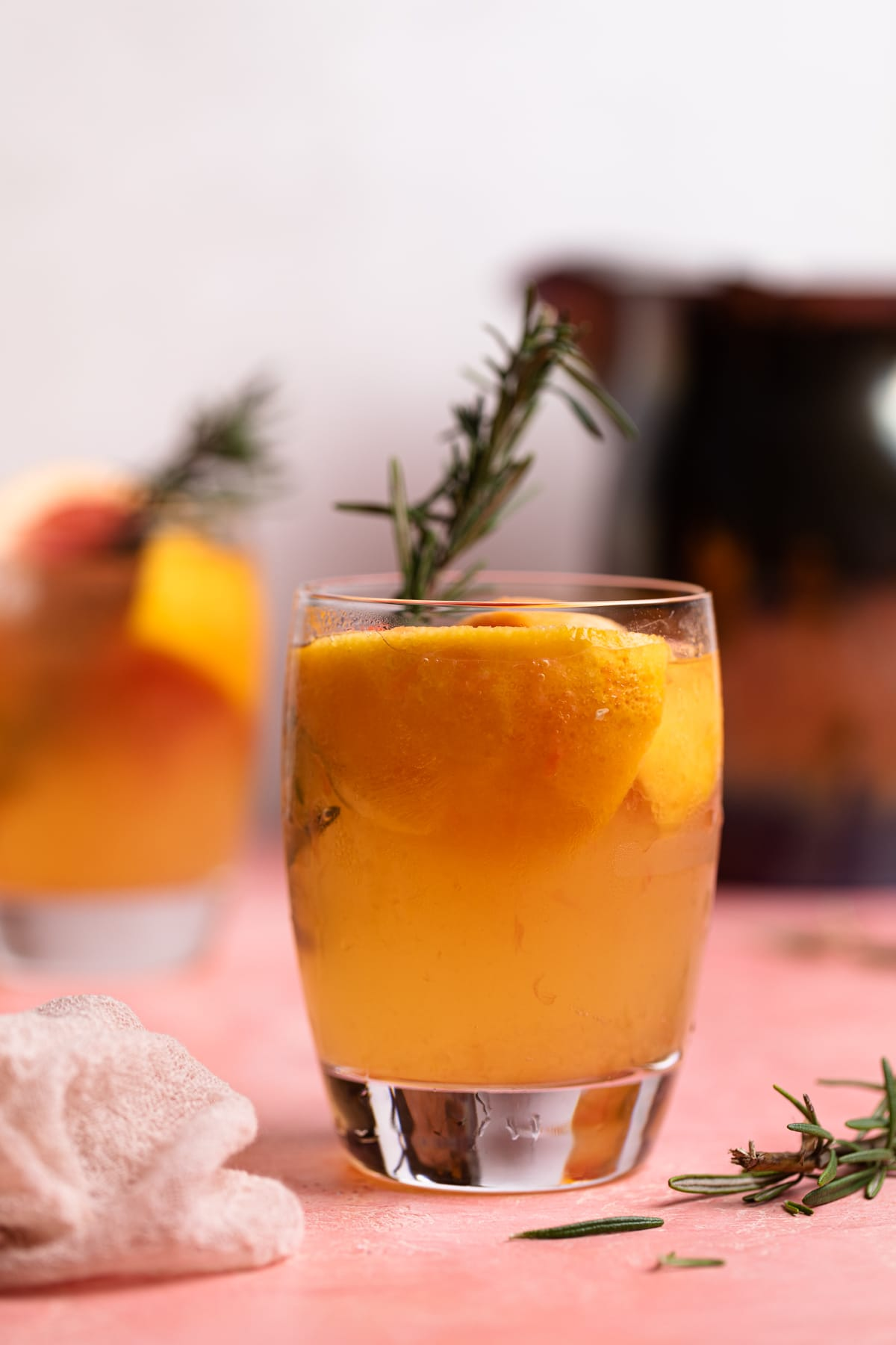 Grapefruit Apple Cider Vinegar drink with fresh rosemary in a glass