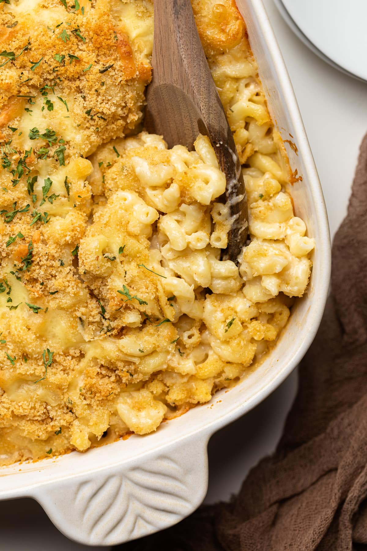 Southern Baked Mac and Cheese with Breadcrumbs with green herbs on top