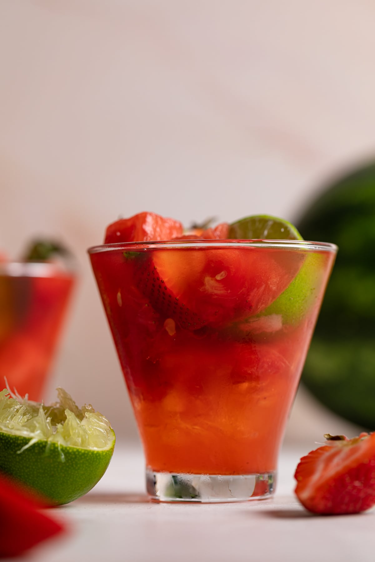 Watermelon Strawberry Lime Mocktail with fresh lime halves