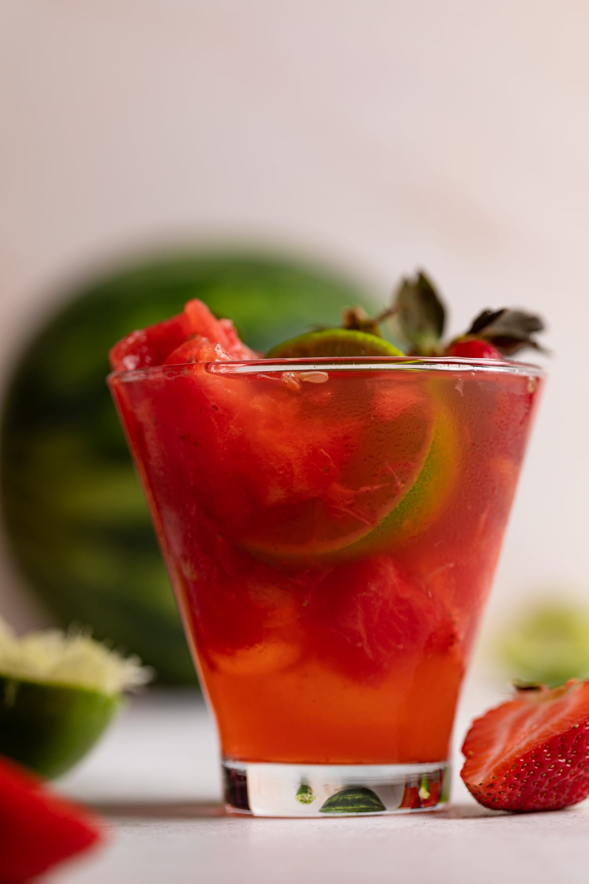 Watermelon Strawberry Lime Mocktail with a half lime inside