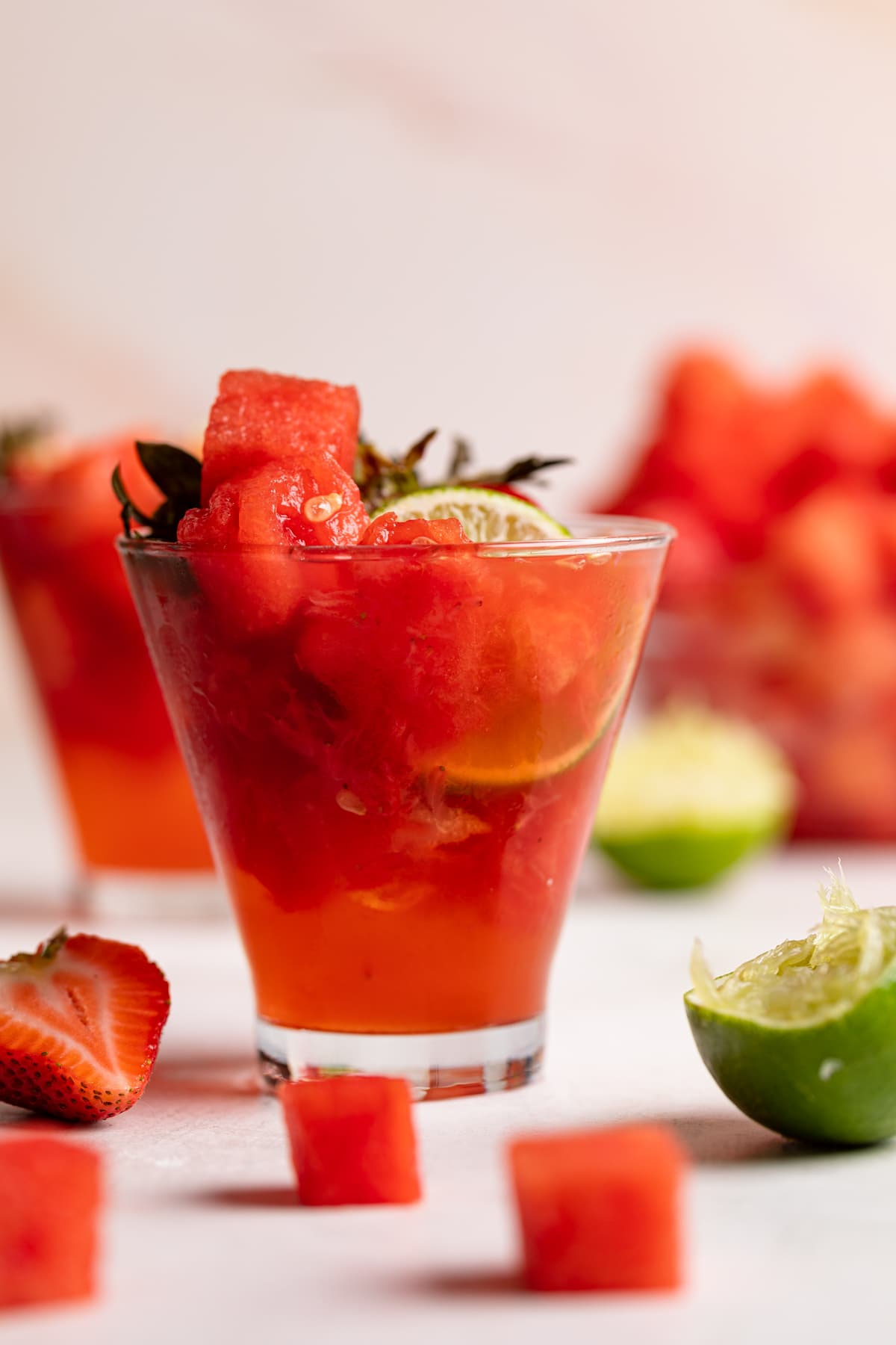 Watermelon Strawberry Lime Mocktail with fresh watermelon cubes, berries and lime halves