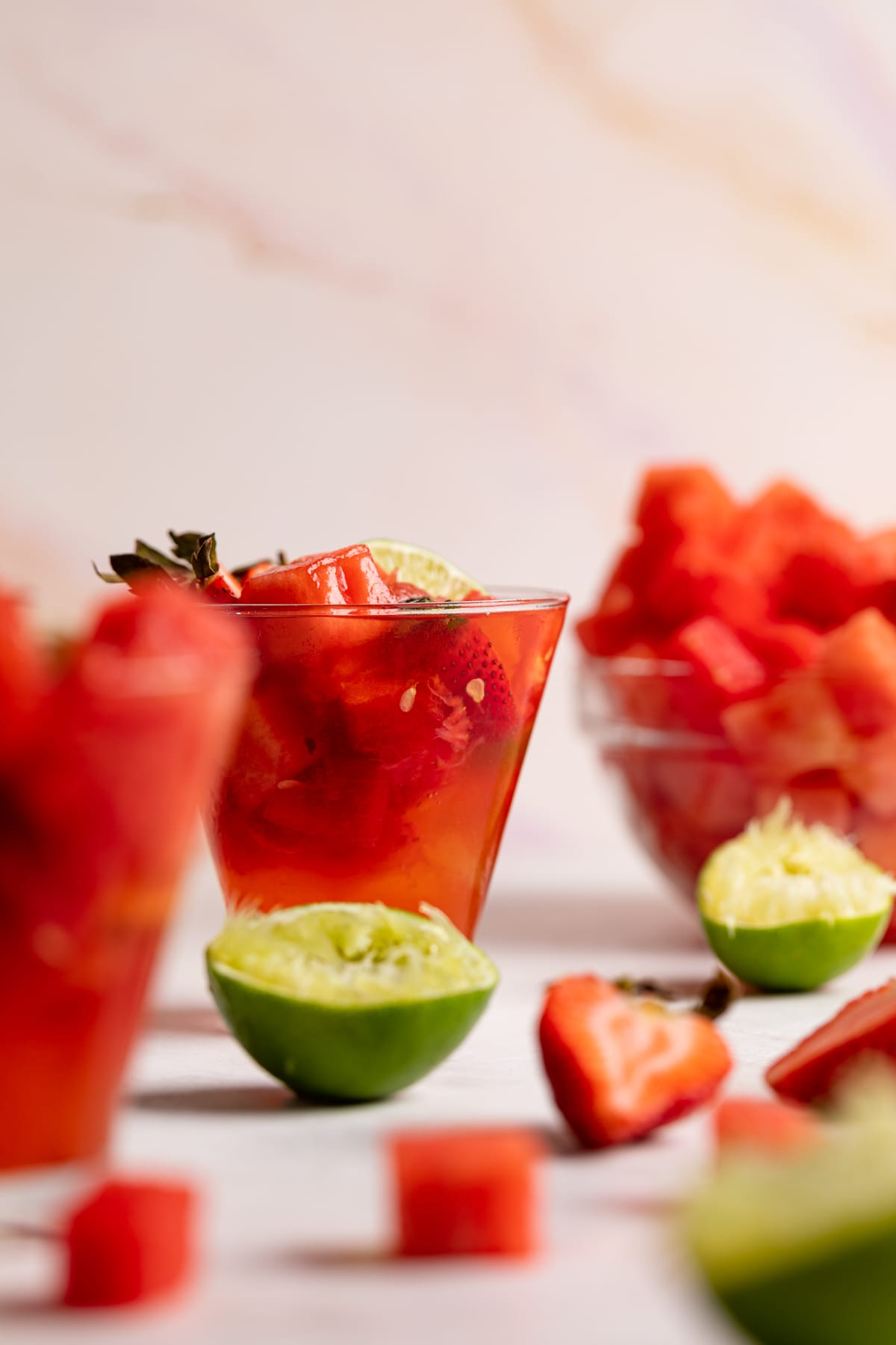 Watermelon Strawberry Lime Mocktail with fresh lime and berries